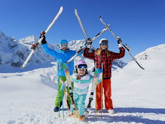 skiers with ski equipment and skis