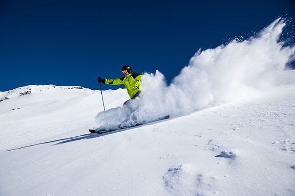 alpine skier skiing downhill