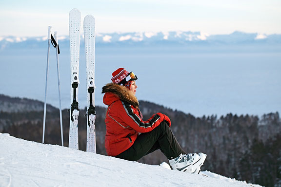 woman skier sitting on a ski slope