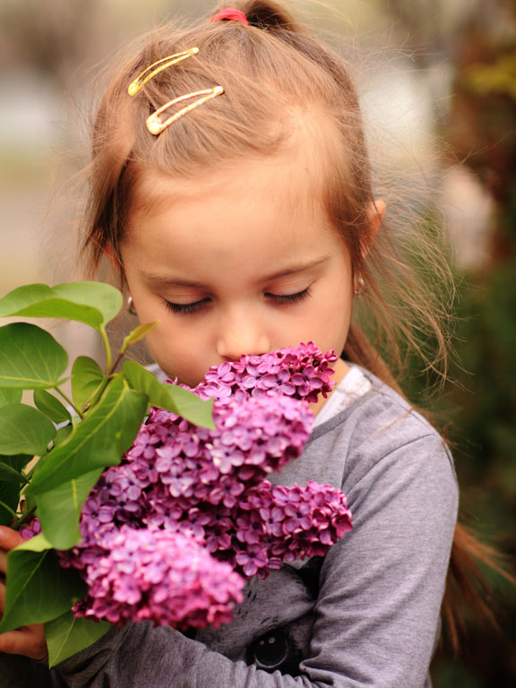 little girl smelling the flowers