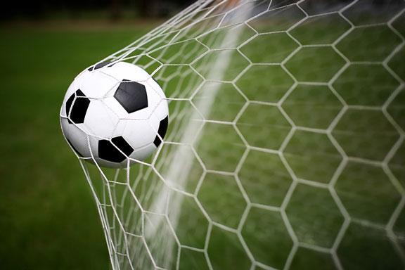soccer ball in a soccer goal net