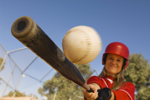 softball player, bat, and softball