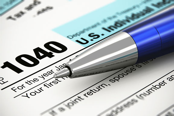 income tax form and ballpoint pen