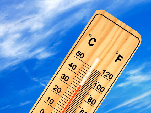 warm temperature reading on a thermometer