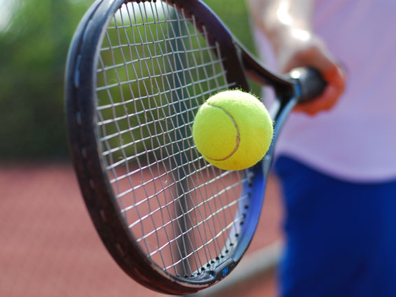 hitting a tennis ball with a tennis racket