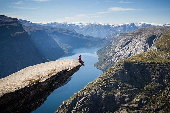man sitting on Trolltunga, Norway