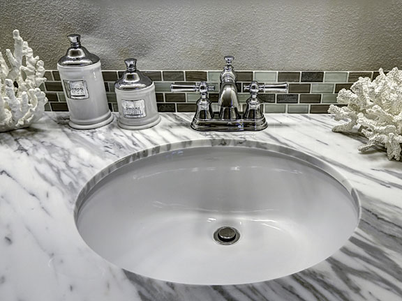 vanity with sink and faucet