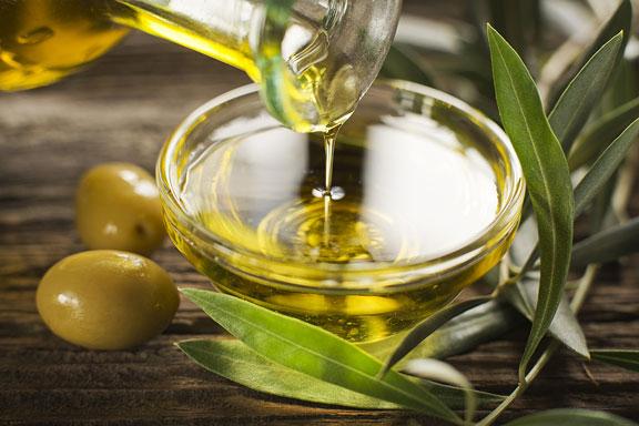 virgin olive oil and fresh olives