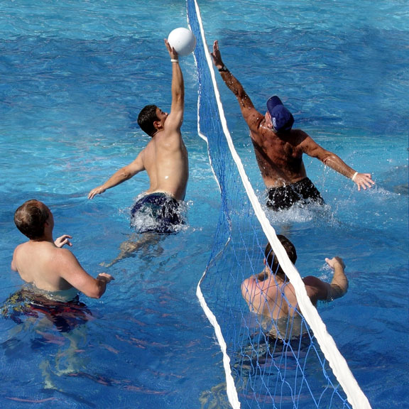 playing water polo in a pool
