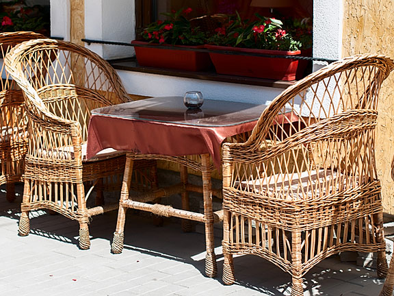 wicker furniture at an outdoor cafe