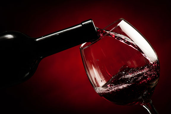pouring a glass or wine